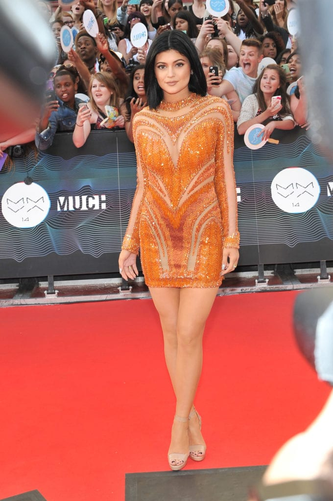 Kylie Jenner dazzles in an orange ensemble at the 2014 Much Music Awards