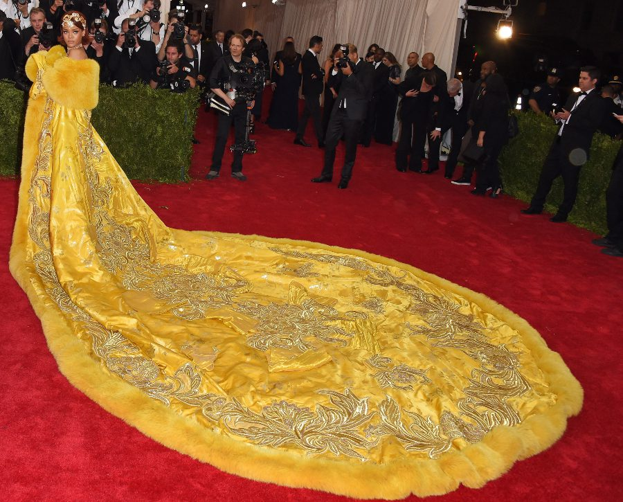 Rihanna wears a jaw-dropping yellow, silver and gold gown to the Met Gala in 2015
