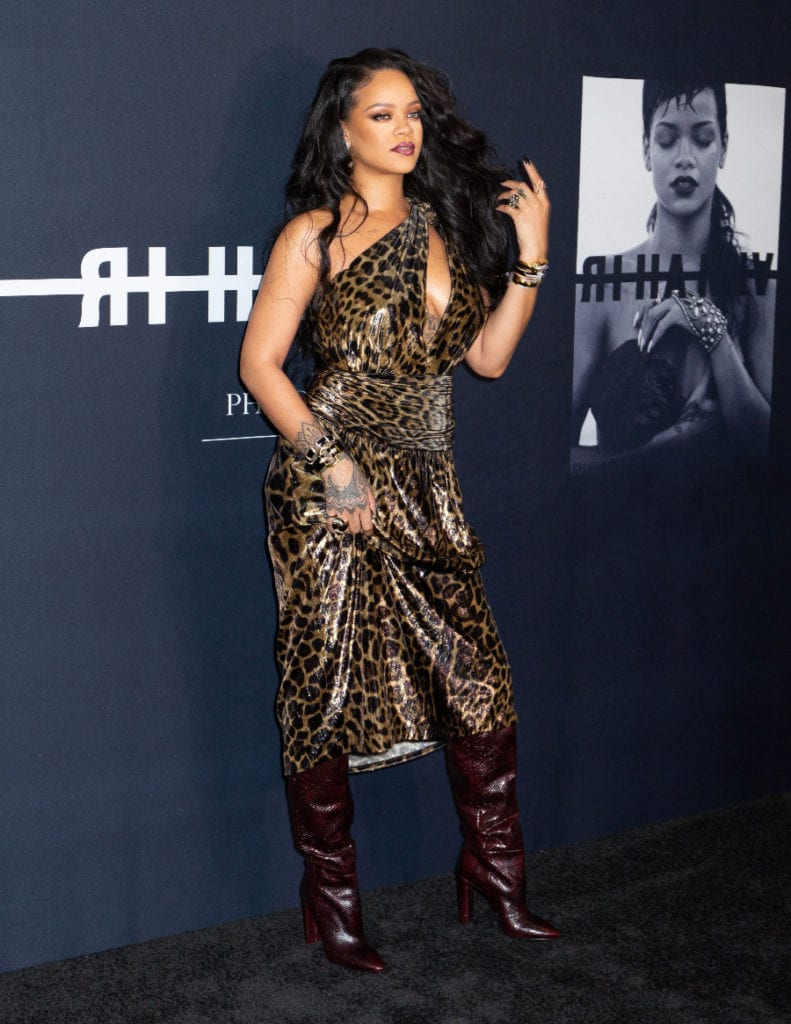 Rihanna attends the premiere of her visual biography in a long, cleavage leopard number