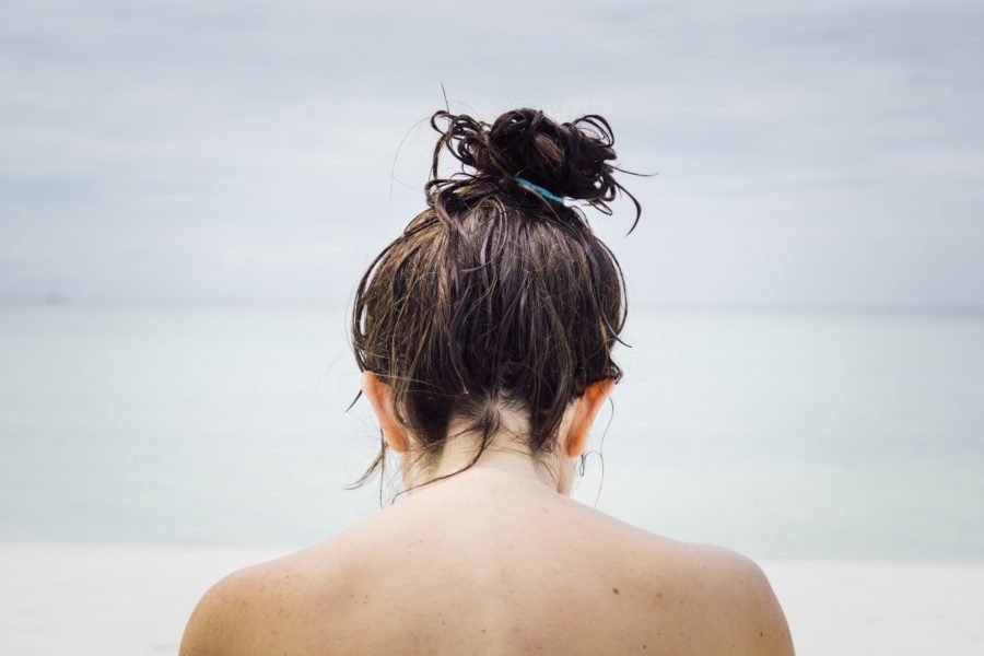 Girl with her wet, brown hair in a messy bun